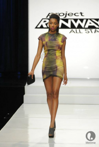 Project Runway contestant Laura Kathleen's too short, too shiny, and covered with too much fringe sleeveless micro-mini dress.