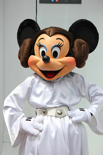 The character Minnie Mouse dressed up in the white dress and donought buns of Princess Leia