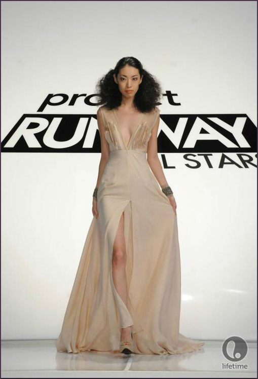 Project Runway All Stars 2x04 designer Uli's model is wearing a frothy, ankle length dress with a bold thigh slit and daring neckline.