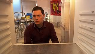 Owen looks into an empty refrigerator, having cleaned it out since he can no longer eat or drink.