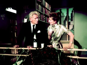 Desk Set movie still: Hepburn and Tracy in the library
