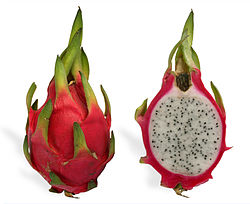 Photo of a whole dragonfruit plus one cut in half.