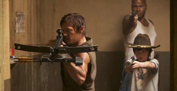 Daryl brandishing a crossbow, Carl and Oscar brandishing guns.
