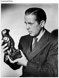 Black and White photo of Bogart as Sam Spade, holding the Falcon