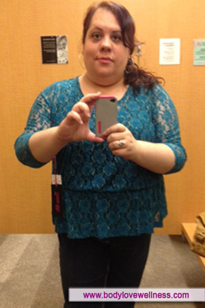 Golda taking a self-portrait in the dressing room mirror at Macy's