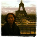 The Eiffel Tower with the author posing in front