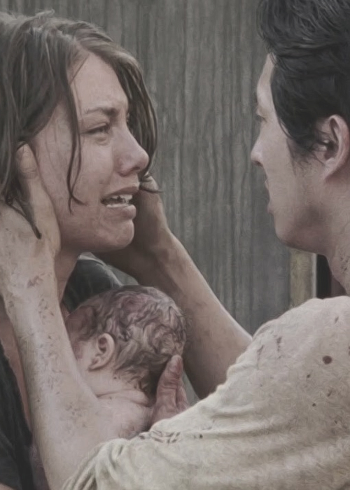 Maggie cries while holding a newborn; Glenn holds her face in his hands