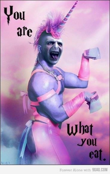 """terrifying photo of unicorn Voldemort with pink and purple hair, purple big arm muscles, flexing with hooved hands. Pink and purple cloud background. In black lettering it says """"You are what you eat"""""""