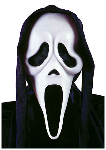 mask from the movie Scream, white face with large, exaggerated mouth and eye holes, black hood.