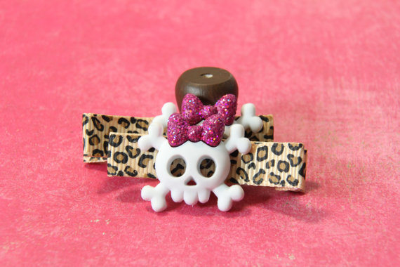 pink background, cheetah print covered clip with white skull with hot pink glitter bow