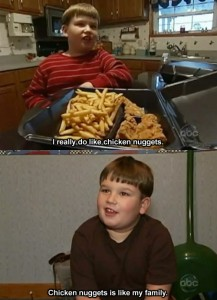 """Boy with a plate of chicken strips and french fries. Subtitles read """"I really do like chicken nuggets. Chicken nuggets is like my family."""""""