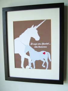 """print of unicorns in sihloette, one large and white, the other small and blue, with the words """"D-cups Are Special, Like Unicorns"""""""