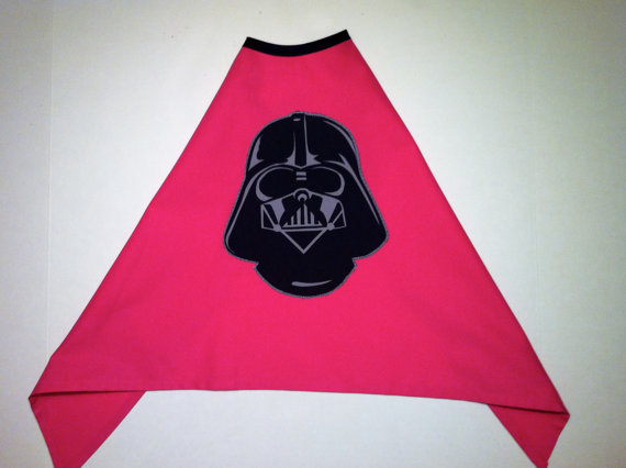 pink cape with black collar and darth vader screen printed on it.