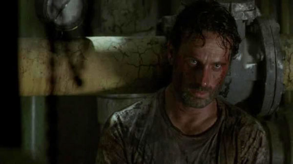 Rick, covered in blood and staring fixedly in a disconcerting manner