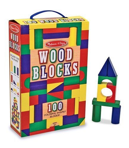 Red, yellow, blue and green wooden block set; small castle built in the background