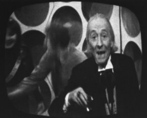 Still from Doctor Who: Feast of Steven, Dec 25th 1965. The first Doctor is wishing the audience a Happy Christmas.