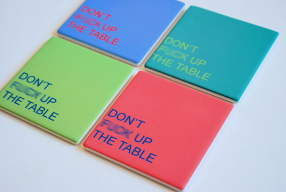 "set of 4 coasters in blue, teal, green and red with the words ""Don't Fuck Up the Table"" printed on them"