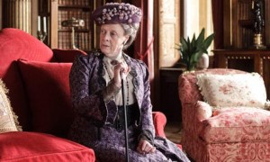 Maggie Smith as Lady Violet, the Dowager Countess from Downton Abbey. She looks displeased.