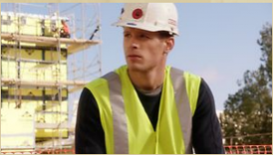 Ryan on a job site, wearing a vest and hard hat