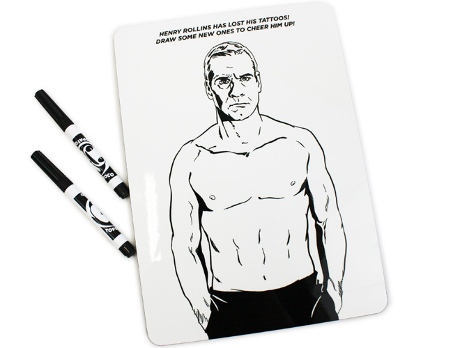 White expo board with outline of Henry Rollins shirtless to draw tattoos on