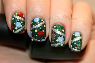 Green nails with silver garland and multicolored ornaments