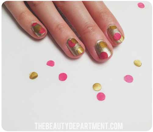 Gold polish with pink and gold tissue paper confetti affixed with clear top coat