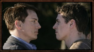 Jack and Gray face-to-face, looking grim.
