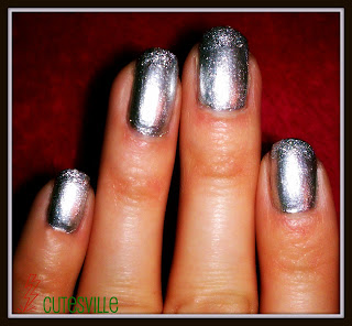 Nails painted silver with glittery tips