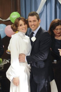 Liz Lemon and Criss at the wedding. He wears a suit; she's dressed as Princess Leia, hair buns and all