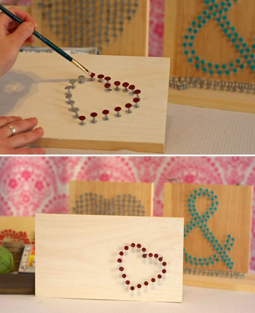 wood square boards with nails hammered into Heart and Ampersand shapes. Head of nails are painted red and blue
