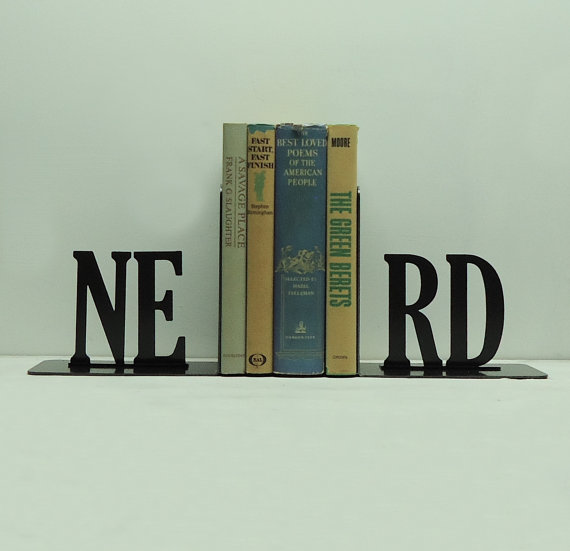 black Iron bookends that spell out NERD holding up four books