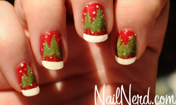 Red nails with evergreens growing in the snow.