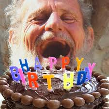 "Photoshop collage of a laughing older man and a chocolate cake with candles that spell out ""Happy birthday"""