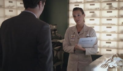 A screencap from the tv show Bones: the character of Daisy looks at the character of Sweets in a business-like manner