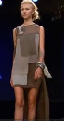 Benjamin's dress: a short sheath dress with squares of different gray fabrics and a longer panel at the back