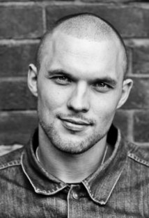 Black and white headshot of Ed Skrein