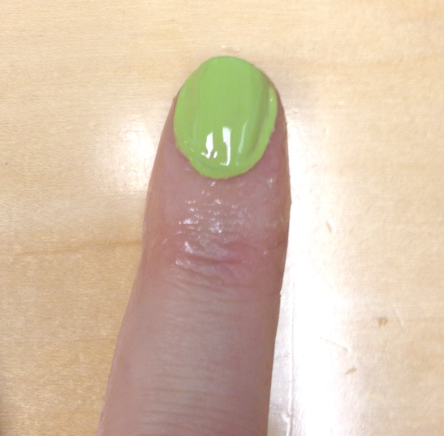 photo of Kym's fingernail with green polish applied haphazardly