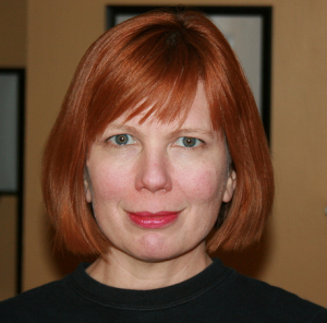 The author, with chin-length hair and slightly uneven bangs.
