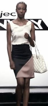 James' Dress: A white tank top and a skirt with black and tan fabric joined on a diagonal