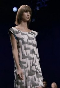 Patricia's dress: overlapping white fabric panels painted gray along the bottom and right edges