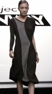 Richard's Dress: A knee-length long-sleeved black dress with a gray panel running down the center