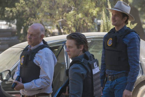 Still from Justified on FX: Art, Tim and Raylan in bullet-proof vests