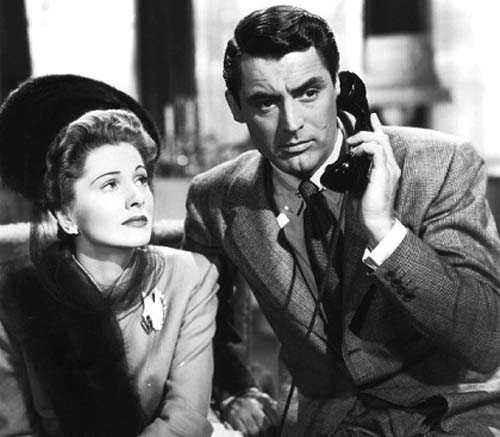 Still from Suspicion of Joan Fontaine and Cary Grant, who's holding a phone to his ear