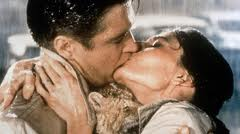 Still from Breakfast at Tiffany's of Holly and Paul kissing in the rain