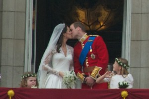 The parents of the royal fetus, the Duke and Duchess of Cambridge, share a kiss after their wedding in 2011.