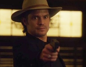 Raylan with a gun in his hands and wide eyes