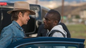 Raylan and Jody stand by the car