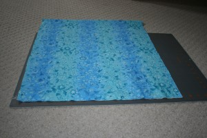 Piece of fabric on a cutting mat.
