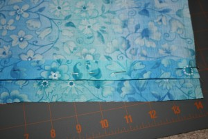 Picture of fabric with top hem pinned down.