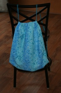 Picture of finished backpack on the back of a chair.